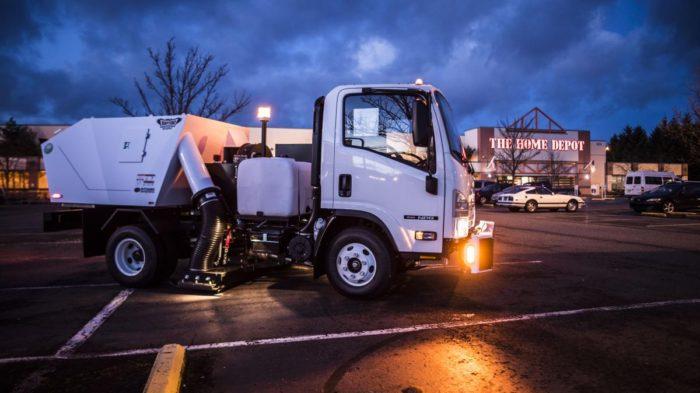Parking lot sweeper truck