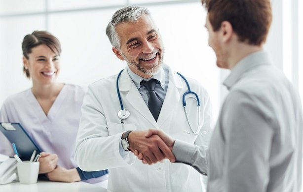 stock-photo-smiling-doctor-at-the-clinic-giving-an-handshake-to-his-patient-healthcare-and-professionalism-390902179
